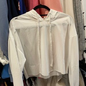 White cropped hoodie with cut designs